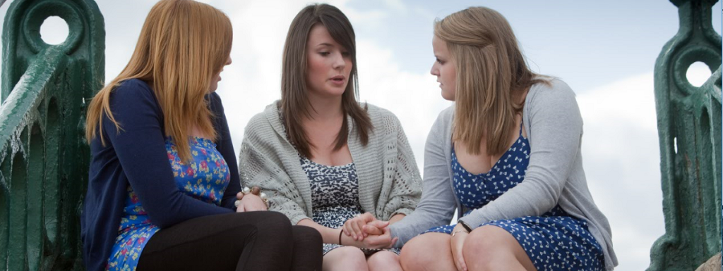 Teenage girls sitting and talking