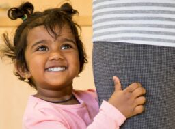 Child Smiling in a Refuge safe house