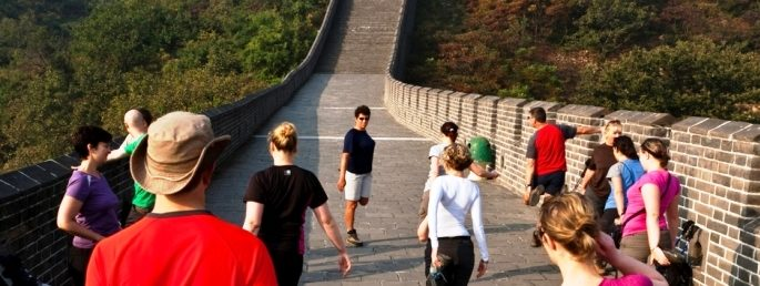 A group of trekkers stretching on the Great Wall of China Trek