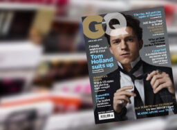 GQ cover in front of magazines