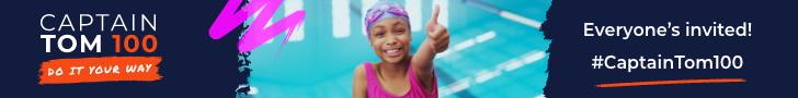 Young girl in swimming pool give a thumbs up to the camera.